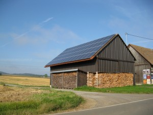A barn, covered in solar panels