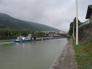A barge going upstream through the locks