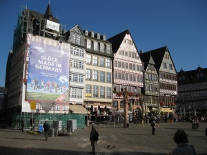 Picturesque buildings in Frankfurt, juxtaposed with a giant billboard
