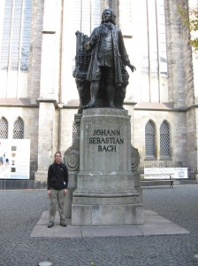 Zach stands next to Bach