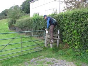 Randy climbing a stile