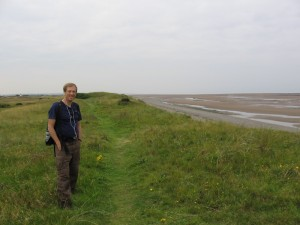 Randy on a grassy path on the Solway Firth coast