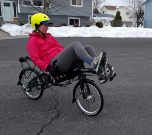 Riding Grasshopper recumbent bike surrounded by snow