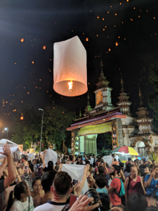 Sky lanterns being released into the air